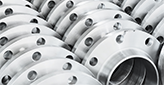 circular stainless steel parts in organized rows