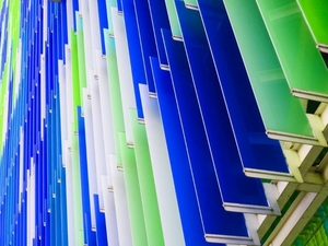 a lot of green white and blue acrylic sheets stacked on one another