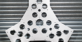 triangular steel part with holes on a garage door