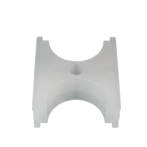 milled curved plastic part with a hole through the middle