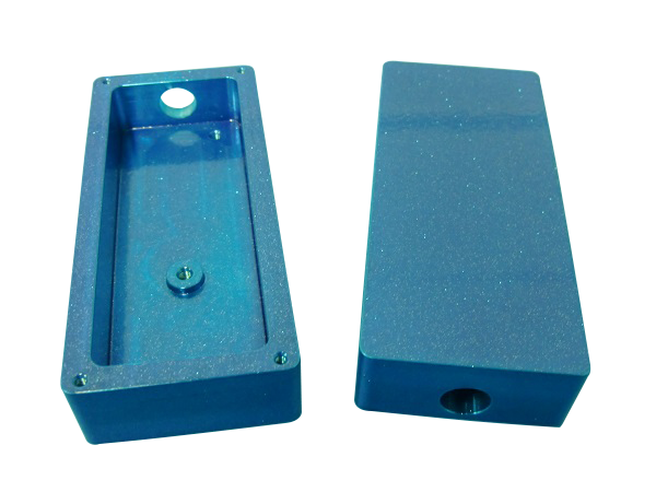 Blue sparkling powder coat machine part box with a hole in it