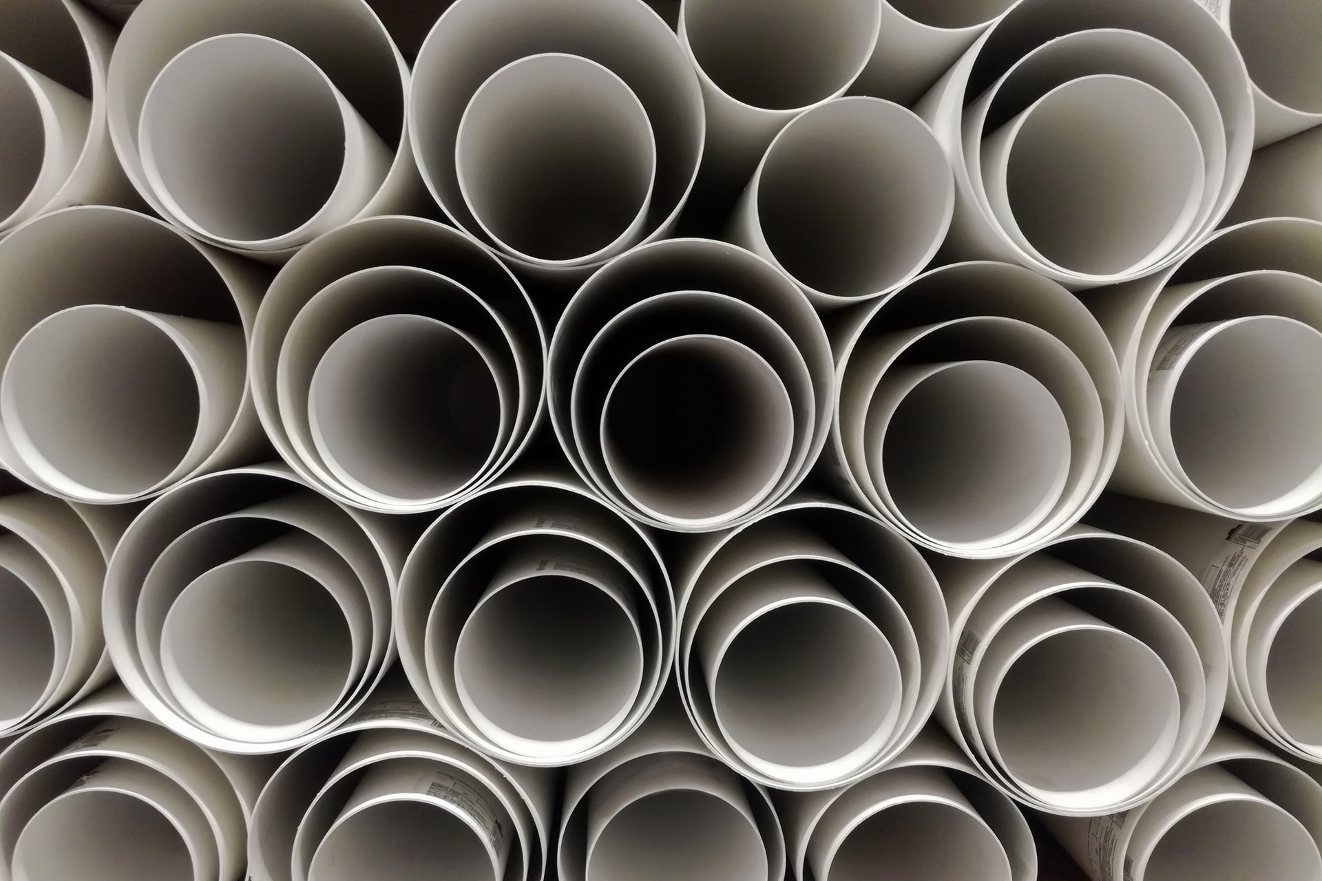 Polypropylene sheets rolled up into tubes stacked on each other
