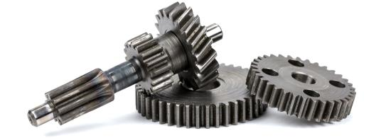 3 steel gears laying on one another